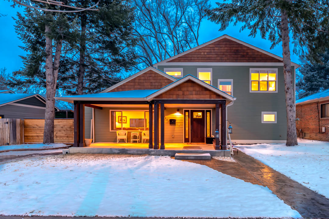 home exterior at night with snow on the ground